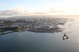 Heletranz aerial image of a helicopter flying towards Auckland city